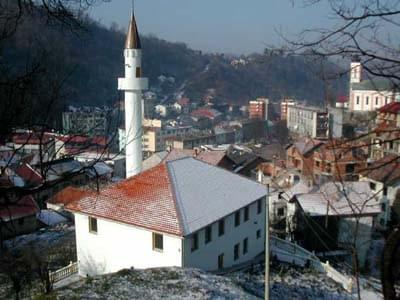 The White Mosque, rebuilt in July 2002, stands above the center of Srebrenica. It is the first mosque repaired in Srebrenica since the war.