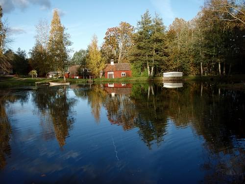 Sweden / Skövde - typical red hut with a small lake