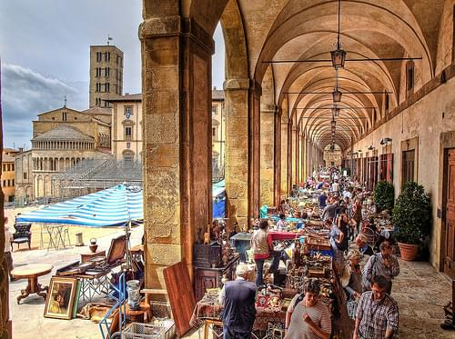 Antiques fair in the Loggia of the Piazza Grande in Arezzo, Italy