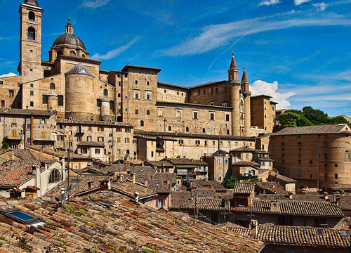 The Cathedral and Ducal Palace rise above the rooftops of Urbino in Italy