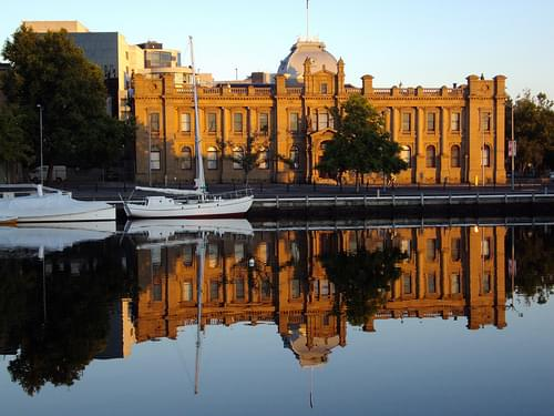 Hobart. Old Customs House reflected in the waters of the docks.