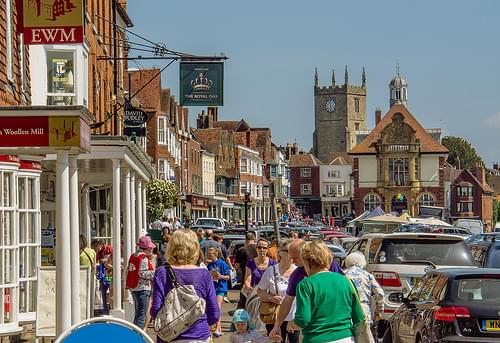 Shoppers throng the Saturday market in the historic High Street of Marlborough, Wiltshire