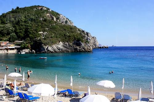 Swimming and sunbathing at the Agios Spyridon beach in Paleokastritsa, Corfu