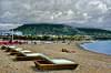 lonely sunbathers on an empty beach in marbella